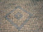 Brick paved driveway with pattern detail