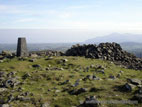 Summit view from Slieve Croob with trig point and cairn