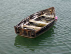 Old rowing boat floating in harbour