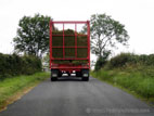 Silage trailer with grass on road