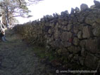Looking along a large dry stone wall