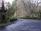 Bridge with turrets on road through Tollymore Forest Park